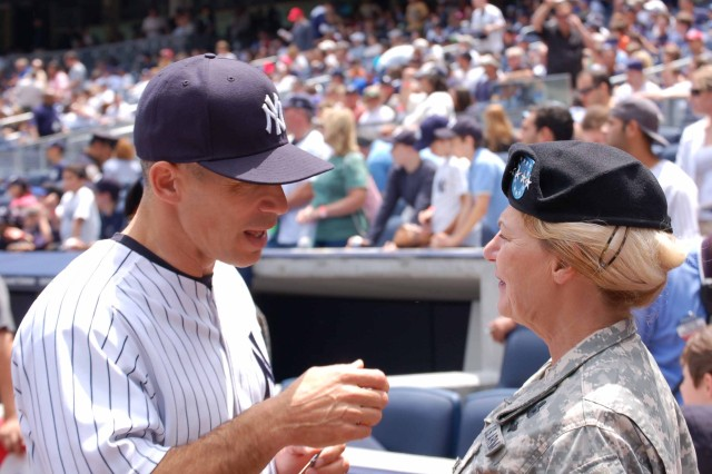 New York Yankees manager Joe Girardi chats with Gen. Anne E. Dunwoody, commander, U.S. Army Materiel Command, prior to the Army Appreciation Game at Yankee Stadium, Bronx, New York, June 14. Dunwoody threw out the first pitch as part of the pre-game festivities in celebration of the Army's 234th Birthday.