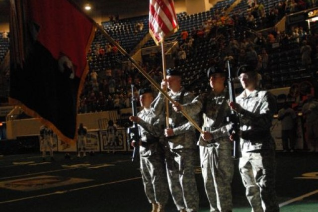 "The color guard composed of 3rd Heavy Brigade Combat Team, 3rd Infantry Division Soldiers, present the colors during the National Anthem during ""Sledgehammer Night"" at the Civic Center in Columbus, Ga., June 13. The Columbus Lions held the event during their game with the Fayetteville Guard, to honor and show support for the Soldiers of the 3rd HBCT."