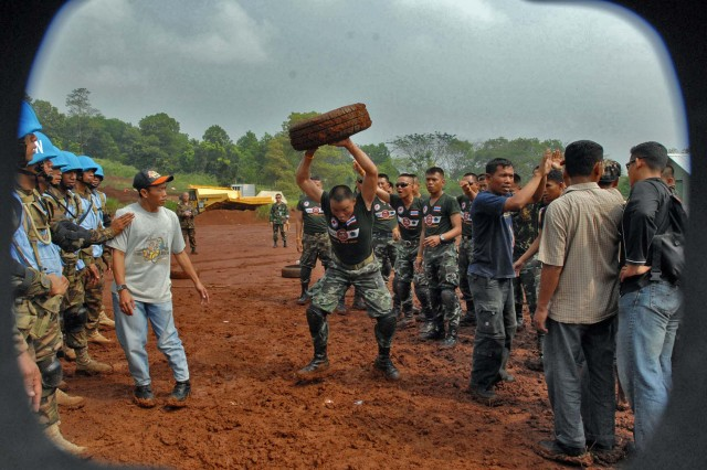 Tongan Royal Marines hold their line as negotiators try and calm the angry crowd before a full blown riot begins during training as part of Garuda Shield 09 June 18. The two week training is at the Tentara Nasional Indonesia -Angkatan Darat, or Indonesian Army, Infantry Training Center in Bandung, Indonesia. The two week exercise brings together Soldiers and Marines from nine Nations to train on UN mandated ground-level tasks.  GS09 is the latest in a continuing series of exercises designed to promot regional Peace and Security.  Training will focus on Peace Support Operations and Global Peace Operation initiative Certification, a Command Post Exercise, a Field Training Exercise and Humanitarian and Civic Assistance Projects.