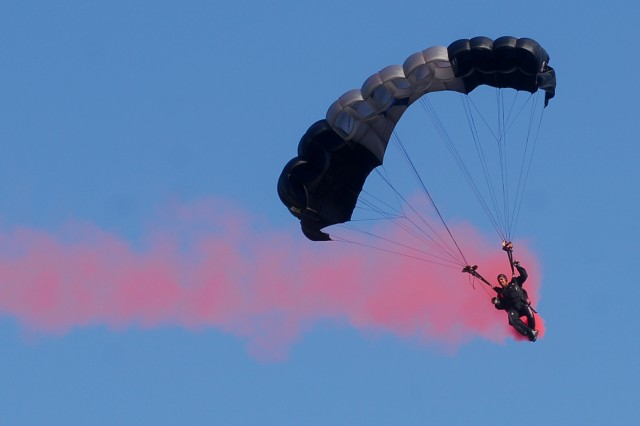 A Silver Wings parachuter performs for the crowd Friday.