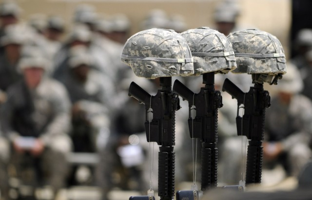 BAGHDAD-Helmets, rifles and dog tags stand in memorial for three Soldiers from the 252nd Combined Arms Battalion, 30th Heavy Brigade Combat Team, who were remembered during a memorial service, May 29, at Forward Operating Base Falcon on the southern ...