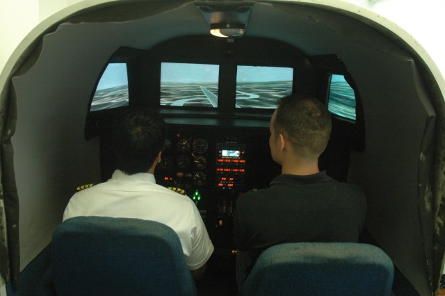 HONOLULU - 1st Lt. Pete Cox, 1st Battalion, 21st Infantry Regiment learns landing techniques on a G1000 Integrated Cockpit System as Flight instructor, Jarom Knight, instructs.