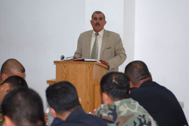 Brig. Gen. Awad, the commander of the Criminal Evidence Unit, speaks to a group of Iraqi investigators that work in and around Kirkuk city during a training meeting at Forward Operating Base Warrior's dining facility May 23. The training was aimed at refreshing skills the investigators learned at the police academy and teach them new investigatory techniques.
