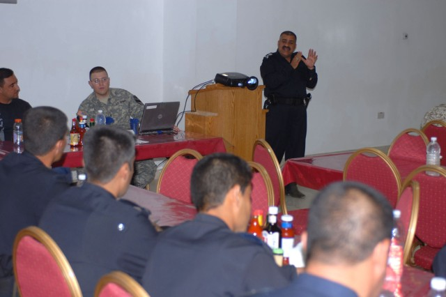 Brig. Gen. Razaq Hussein, one of the head officers at the Kirkuk police academy, speaks to a group of Iraqi Police investigators during a training meeting at Forward Operating Base Warrior's dining facility May 23. The training taught the officers new investigation techniques that will hopefully allow them to make progress on current cases, as well as, prepare them for future ones.