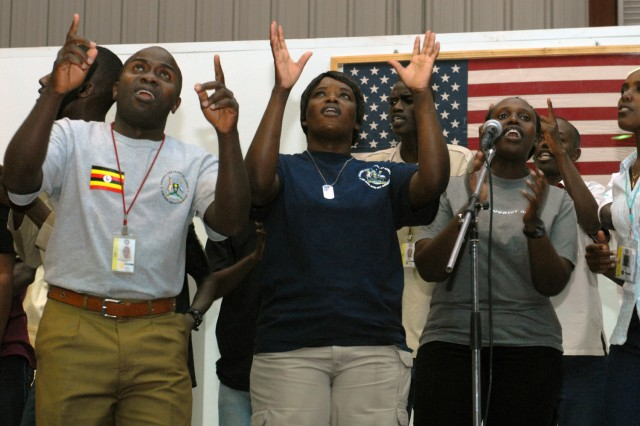 VICTORY BASE COMPLEX, Iraq - A choir, comprised of Ugandan security personnel, raise their voices in praise at a revival here, May 30. A different chapel led the revival each night during the five-day event, which culminated on the Global Day of Prayer.