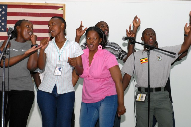 VICTORY BASE COMPLEX, Iraq - A Ugandan choir sings during a revival service here, May 30. People filled the Liberty Field House here, to gather in fellowship and worship.