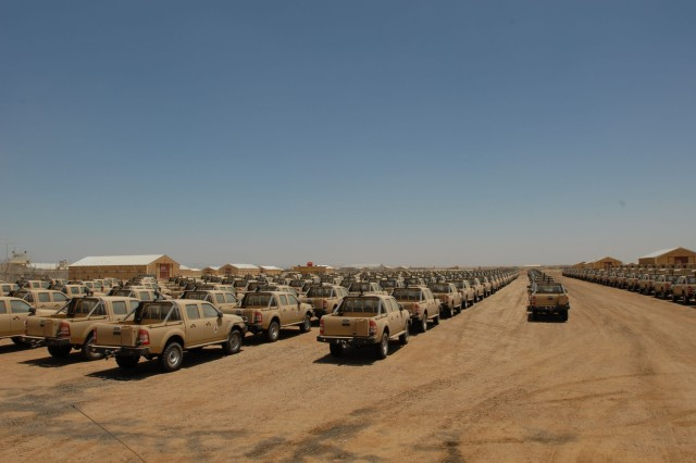 Rows of vehicles stand staged at the Taji National Supply Depot, May 30. The depot is the Iraqi Army's national level logistics and supply center.