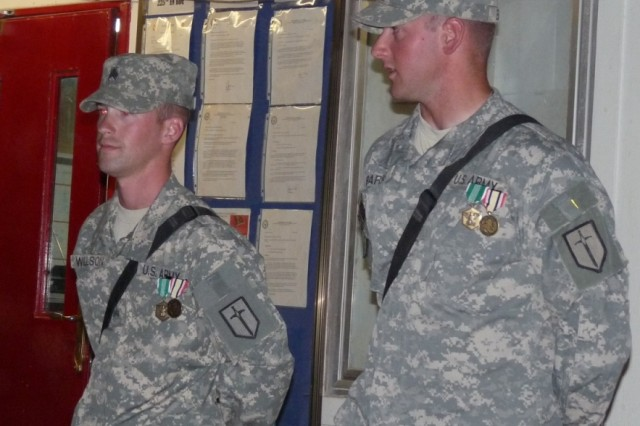 BAGHDAD - The 31st Concrete Team's advance party of Sgt. Kellen Barns (right) and Sgt. Seth Willson, both of the 46th Engineer Combat Battalion (Heavy), 225th Engineer Brigade, say a few words to their platoons during their Iraq end of tour awards ceremony, May 28 before departing for Afghanistan.  The two Soldiers are members of the concrete team selected to improve the living conditions of Soldiers fighting in Afghanistan.