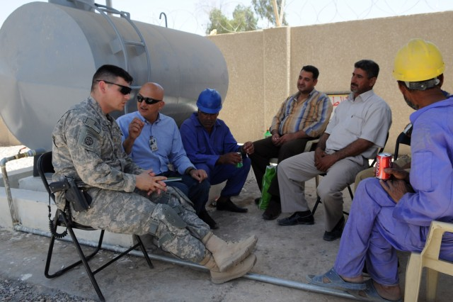 BAGHDAD - Maj. Alan Mckewan (left), of Scottsdale, Ariz., a civil affairs officer assigned to Headquarters and Headquarters Company, 3rd Brigade Combat Team, 82nd Airborne Division, Multi-National Division-Baghdad, meets with workers of the Zafaraniya Sewage Pump station during a visit, May 31, in the al-Karradah district of eastern Baghdad. Paratroopers, along with civil affairs and U.S. Army Corps of Engineer personnel, visited the site to meet with sewage officials and get a first-hand look at the pump station's capabilities and how it assist the region with the removal of sewage to other processing sites.