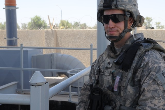 BAGHDAD - Sgt. Nathaniel Wray, of Troutdale, Ore., assigned to Headquarters and Headquarters Company, 3rd Brigade Combat Team, 82nd Airborne Division, Multi-National Division - Baghdad, walks on the catwalk of the Zafaraniya Sewage Pump station during a visit, May 31, in the al-Karradah district of eastern Baghdad. The visit allowed Coalition Forces to get a first-hand look at the new facility and meet with the plant's officials.