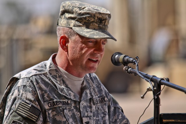 """CAMP TAJI, Iraq-Colonel Douglas Gabram, from Cleveland Ohio, the commander of the 1st Air Cavarly Brigade, 1st Cavalry Division, Multi-National Division-Baghdad, delivers a speech during the transfer of authority ceremony held on Camp Taji, Iraq, June 2. The 1st ACB takes over the mission that the Combat Aviation Brigade, 4th Infantry Division, MND-B, has supported for the last 12 months. """"We have assembled a great team here, it's our team and it's the First Team. [Maj. Gen. Bolger], the Air Cav is checking in,"""" said Gabram."""