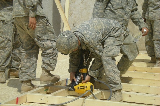 BAGHDAD - Soldiers of 1st Platoon, Company A, 46th Engineer Combat Battalion (Heavy), frame a wall on a B-Hut that will provide housing for Soldiers at Patrol Base Yusifiyah.  The final construction and upgrades will be completed in mid-June.