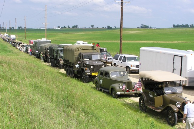 The convoy takes a 10 minute comfort break in the midle of an Iowa wheat field.