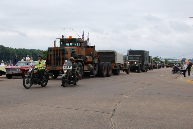 Dark clouds and drizzle hang over the 2009 MVPA convoy as it arrives in Clinton, Iowa, having covered about 1,000 miles in its coast-to-coast journey. Poor weather didn't deter more than 100 area residents and veterans from attending the event.