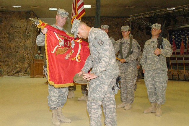 Lt. Col. Christopher O. Mohan, 80th Ordnance Battalion commander, and Command Sgt. Maj. Kenneth Tincknell, 80th Ord. Bn. Senior enlisted leader, uncase their units colors during a transfer of authority ceremony at Joint Base Balad June 17. The 80th Ord. Bn., an active-duty unit based at Fort Lewis, Wash., assumes command and control of units formerly assigned or attached to the 259th Combat Sustainment Support Battalion during its deployment to Iraq