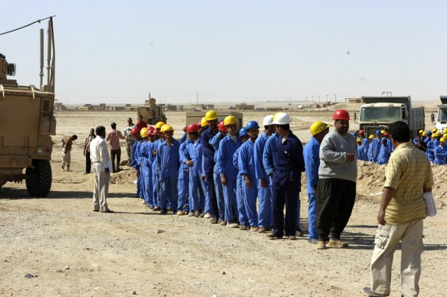 The honor students of the phase one graduating class of the Tal Abtha Road Project line up at a ceremony in preparation to receive their certificate and a gift for their exceptional work on the project and during training May 24. Their training started in December 2008 and continued while they were building road.