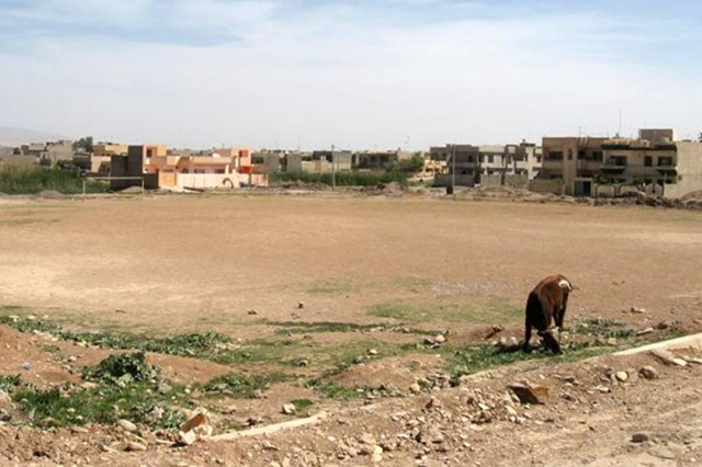 This empty lot was the prime spot picked to open a soccer field in the 7 Nissan neighborhood of Mosul May 30. Coalition forces coordinated with neighborhood locals to help fund and build the soccer field that replaced this empty lot.