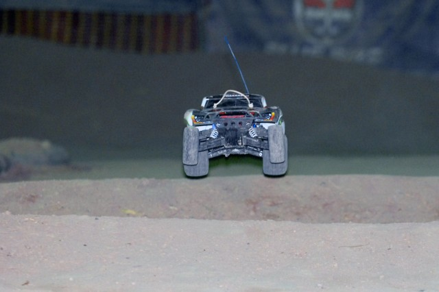 "BAGHDAD - A remote control car catches air off a jump during a race held weekly between service members on Camp Liberty, Iraq. The dirt track, built roughly four years ago by service members stationed here, is full of twist and turns to test the skills of each RC car operator and add to the racing excitement of the spectator. This Soldier hobby has increased in participation lately for one reason, ""I got four hours where I almost forget that I am even in Iraq,"" said Spc. Krider McCan from Pineville, La."