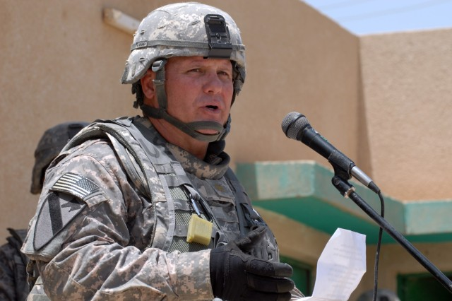 """BAGHDAD - Maj. Jeffrey Schrick, a Fredrick, Okla., native and commander of 2nd Battalion, 8th Cavalry Regiment, 1st Cavalry Division, delivers a speech to local members of the community and the school staff at the Zoba Village High School, June 4.  """"This is the first of many projects like this in the Zoba area,"""" Schrick said."""