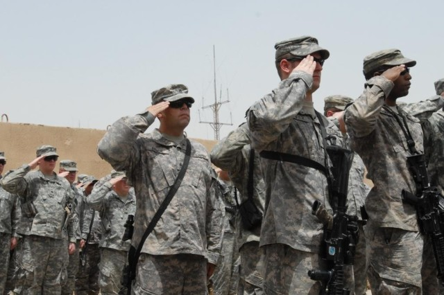 CAMP TAJI, Iraq - Soldiers from 3rd Platoon, Company B, 1st Battalion, 111th Infantry Regiment, 56th Stryker Brigade Combat Team, salute during the dedication of the Baum Fitness Center.  Staff Sgt. Mark Baum, a member of 3rd Platoon, was killed in action Feb. 21, 2009, north of Camp Taji.