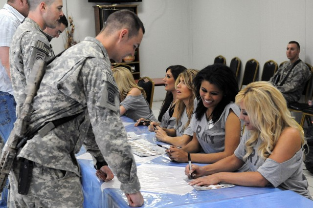 BAGHDAD - Paratroopers assigned to the 3rd Brigade Combat Team, 82nd Airborne Division, Multi-National Division-Baghdad, get autographs from the NFL's Oakland Raiders cheerleaders, June 4, at Joint Security Station Loyalty located in the 9 Nissan district of eastern Baghdad. The Raiderettes signed autographs and took pictures during a meet and greet session before performing a show, which included several dance routines and other activities.
