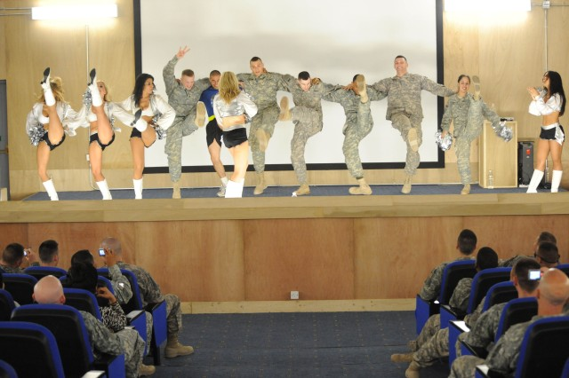 BAGHDAD- Paratroopers assigned to the 3rd Brigade Combat Team, 82nd Airborne Division, Multi-National Division-Baghdad, dance with cheerleaders from the NFL's Oakland Raiders June 4 during a Morale, Welfare and Recreation event at Joint Security Station Loyalty, located in the 9 Nissan district of eastern Baghdad., The cheerleaders, known as the 'Raiderettes' did several dance routines before inviting some Paratroopers to come on stage and dance along with them. The show at JSS Loyalty was the last one the Raiderettes performed during their two week MWR tour of Iraq.