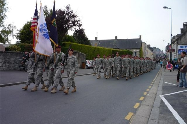 Paratroopers from the 82nd Airborne Division march into the French town of St. Mere Eglise, after their airborne operation commemorating the 65th Anniversary of D-Day held this June.