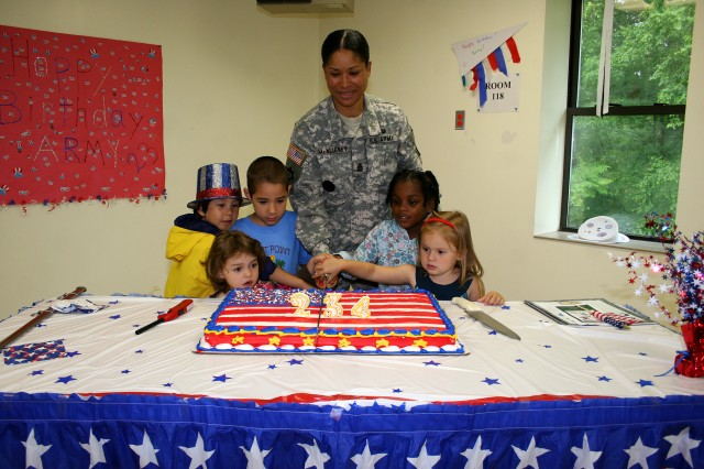 "The West Point Child Development Center celebrated the Army Birthday on June 18 as  Command Sgt. Maj. Violet McNeirney, West Point Garrison Command Sgt. Maj., cut the birthday cake with help from (front row l-r) Megia Roman, Annika Paumgard, back row l-r) Herb Radmacher, Cameran Matthews and Olivia Joyner.  McNeirney read the story ""Sam the Army Dog"" to the children before everyone enjoyed cake. (Photo by Kathy Eastwood/Pointer View)"