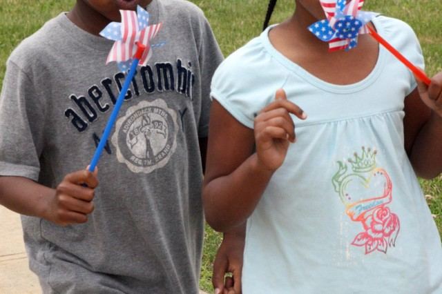 Kalen Cobb, 5, and Taj Johnson, 5, march to Army band music and spin pinwheels during a parade to celebrate the Army's birthday June 17 at the Child Development Center on West Point. Kalen, Taj and their classmates decorated different styles of hats and banners to display during the parade.  (Photo by Emily Tower/Pointer View)