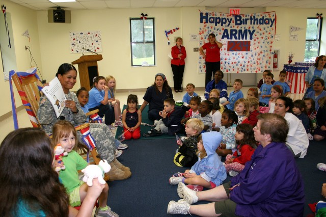 "Command Sgt. Maj. Violet McNeirney, West Point Garrison CSM, reads ""Sam the Army Dog"" to children from the Child Development Center June 18 to celebrate the Army's 234th birthday. (Photo by Kathy Eastwood/Pointer View)"