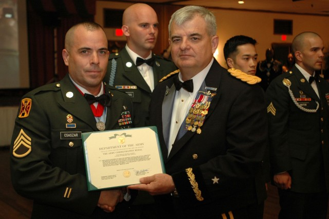 Staff Sgt. Frank Csaszar, 5th Battalion, 3rd Field Artillery Regiment, 17th Fires Brigade, is Fort Lewis' 2009 NCO of the Year. Brigadier Gen. Jeff Mathis III, I Corps deputy commanding general and acting commanding general of Fort Lewis, awarded Csaszar an Army Commendation Medal during the Army Ball June 11 at American Lake Community Center.