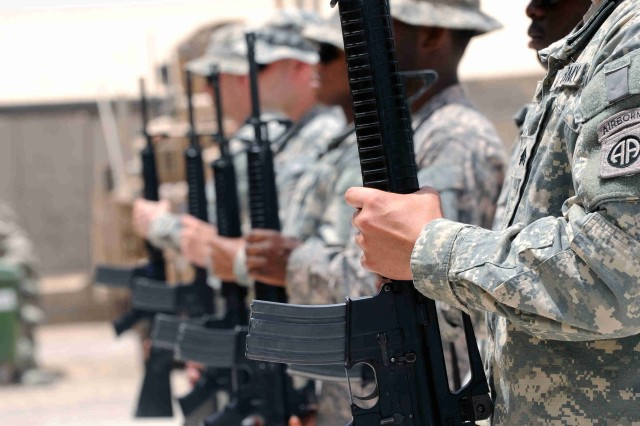 BAGHDAD - Paratroopers of the 3rd Brigade Combat Team, 82nd Airborne Division, Multi-National Division-Baghdad stand in attention as they prepare to fire the volleys for Sgt. Justin Duffy, June 7, at Joint Security Station Loyalty. Duffy served as a team leader for the personnel security detachment for Headquarters and Headquarters Company, 3rd BCT, 82nd Abn. Div. He was killed when an improvised explosive device struck his vehicle during combat operations, June 2, in Baghdad.