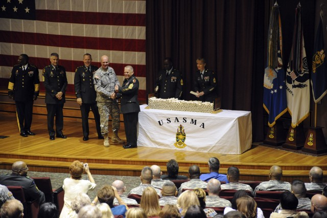 Command Sgt. Maj. Neil Ciatola (center), III Corps and Fort Hood, shakes the hand of a graduate during ceremonies held June 19 at the U.S. Army Sergeants Major Academy, Fort Bliss, Texas. The Academy graduated 274 students from the Nonresident Sergeants Major Course. Ciatola was joined on stage to present the diplomas by (r-l) Academy Commandant Col. Donald Gentry, Command Sgt. Maj. Raymond Chandler and Sgt. Maj. Leo Adams, director of the nonresident course.