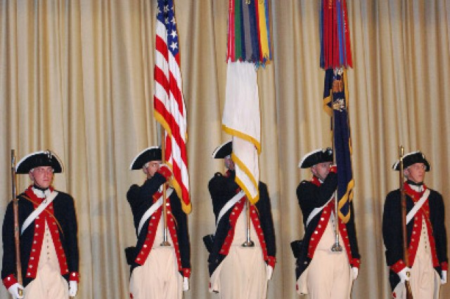 """The Color Guard of the 3rd Infantry Regiment, """"the Old Guard,"""" present the colors to start the Twilight Tattoo at Fort Hamilton, New York's Post Theater June 19. (U.S. Army Photo by Harry Sarles)"""