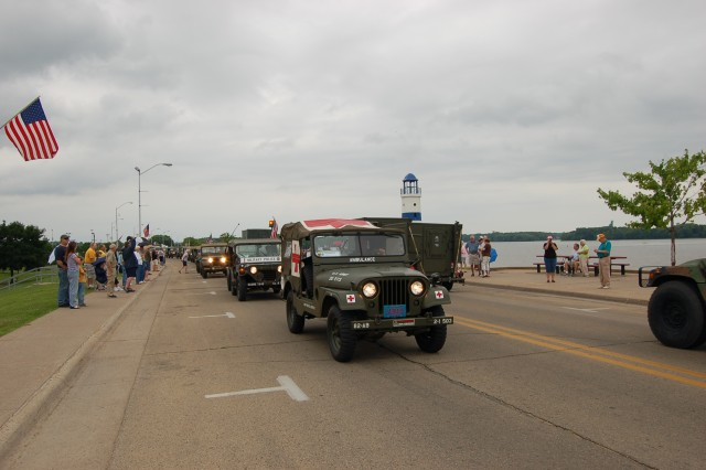More than 50 historical military vehicles crossed the Illinois border into Iowa on June 21, 2009. Day 9's lunch stop was in Clinton, Iowa, where locals lined the street in preparation to welcome their guests.