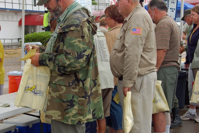 Boy Scouts from Troop 642, Clinton, Iowa, donate their time to help feed lunch to members of the 2009 MVPA Convoy.