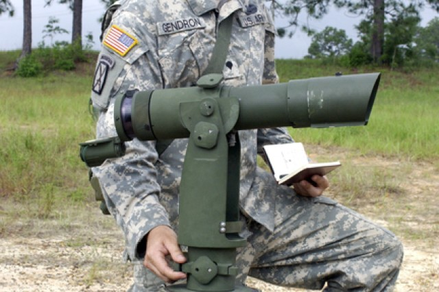 Spc. Keith Gendron, a cannon crewmember assigned to Battery A, 5th Battalion, 25th Field Artillery, 4th Infantry Brigade Combat Team sets a collimator -- a primary aiming reference -- for a 105mm M119A2 Towed Howitzer during training.