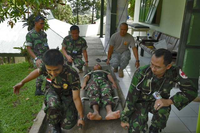 BANDUNG, Indonesia - Staff Sgt. Ronald Rios, a medic assigned to 1st Battalion, 294th Infantry Regiment, Guam National Guard gives training on litter carries to medics from the Tentara Nasional Indonesia-Angkatan Darat, or Indonesian Army Soldier, during Garuda Shield 09, at the TNI-AD Infantry Training Center in Bandung, Indonesia June 19.  Garuda Shield is a two week exercise brings together Soldiers and Marines from nine Nations to train on the UN mandated ground-level tasks.  GS09 is the latest in a continuing series of exercises designed to promote regional peace and security.  Training will focus on peace Support Operations and Global Peace Operation Initiative Certification, a Command Post Exercise, a Field Training exercise and Humanitarian and Civic Assistance Projects.