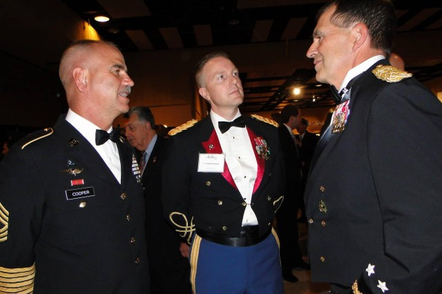 Gen. Peter Chiarelli, the Army's vice chief of staff, visits with Garrison Command Sgt. Maj. Rick Cooper, left, and Garrison commander Col. Bob Pastorelli, center, during a reception prior to the Salute Dinner on June 17 at the Von Braun Center.
