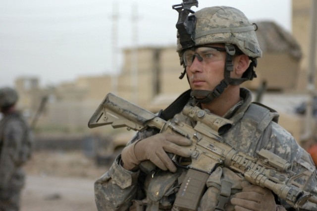 BAGHDAD - Staff Sgt. Mike Johnson, of Centreville, Va., a platoon sergeant assigned to the scout platoon, 2nd Battalion, 505th Parachute Infantry Regiment, 3rd Brigade Combat Team, 82nd Airborne Division, Multi-National Division-Baghdad, checks his surroundings, June 10, for anything suspicious during a time sensitive target training mission in the neighborhood of Beladiyat, located in the 9 Nissan district of eastern Baghdad. The Paratroopers trained their Iraqi counterparts on the proper procedures of entering and clearing a house.