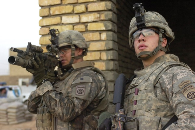 "BAGHDAD - Sgt. James ""Big Sarge"" Mobley (left), of Highlands Ranch, Colo., uses his optical system to check a building in the distance as Spc. Matthew Swann, of Balitmore, Md., observes the area looking for anything suspicious during a time sensitive target training mission, June 10, in the 9 Nissan district of eastern Baghdad. The Paratroopers trained their Iraqi counterparts on the proper procedures of entering and clearing a house. Both Paratroopers are assigned to the scout platoon, 2nd Battalion, 505th Parachute Infantry Regiment, 3rd Brigade Combat Team, 82nd Airborne Division, Multi-National Division-Baghdad."