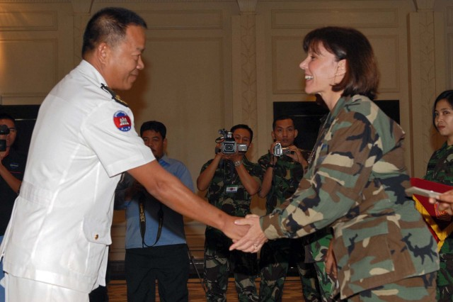 U.S. Air Force Brig. Gen. Pamela Milligan, Headquarters U.S. Pacific Command, shakes hands with a Cambodian officer at the Garuda Shield Command Post Exercise closing ceremony in Bandung, Indonesia, June 22. The five-day, computer-simulated exercise focused on uniting 19 nations to execute a Department of Peacekeeping Operations plan as part of a UN Forces Headquarters.