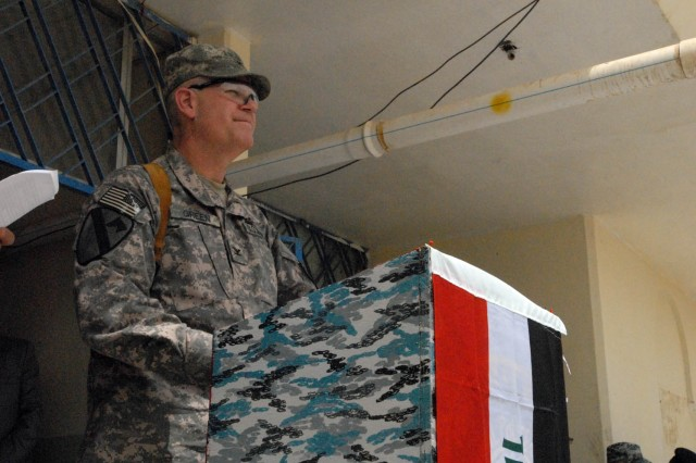 Sioux Falls, S.D., native, Col. Tobin Green, commander of the 1st Brigade Combat Team, 1st Cavalry Division, addresses the audience at the transfer ceremony of Joint Security Station Basateen, June 8.