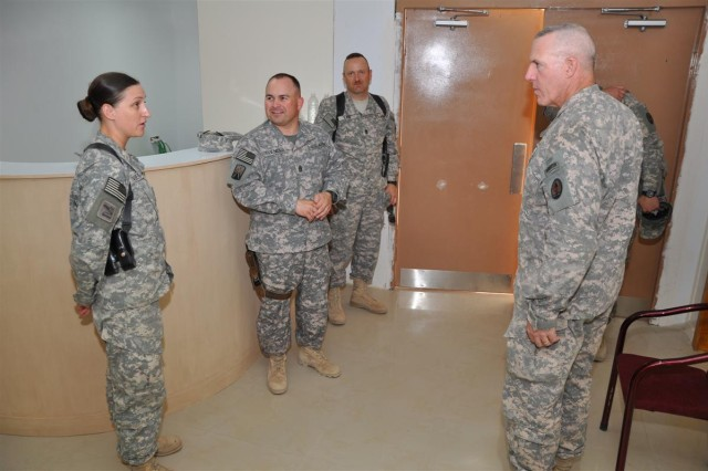 Sgt. 1st Class Christine Viene, assistant plans and operations noncommissioned officer in charge, Q-West Mayor Cell, 181st Brigade Support Battalion, 16th Sustainment Brigade, shows the new Q-West Education Center to Command Sgt. Maj. Frank A. Grippe right, command sergeant major, Multi-National Corps - Iraq, in the foyer at the center at Contingency Operating Base Q-West, Iraq June 5. Also pictured: Command Sgt. Maj