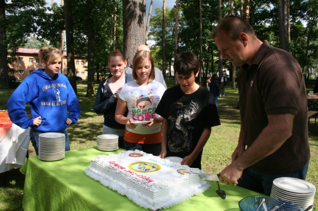 BAMBERG, Germany -- Lt. Col. Gary Rosenberg, commander of U.S. Army Garrison Bamberg, cuts the cake for attendees of the Army Birthday Celebration at the Warner Conference Center June 12. Education was this year's theme for the Army's 234th Birthday.