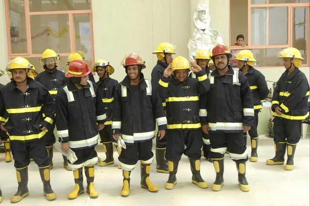 BAGHDAD -Firefighters stand in formation at the opening ceremony for the Nasir Wa Salam Fire Station in Abu Ghraib June 11. The fire station is the second to be opened in the county, which is kept secure by Iraqi Security Forces and elements of the 2nd Heavy Brigade Combat Team, 1st Infantry Division, Multi-National Division - Baghdad.