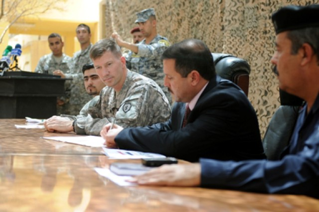 CONTINGENCY OPERATING BASE SPEICHER, TIKRIT, Iraq- (From left to right) Lt. Col. David Hodne, squadron commander, 3rd Squadron, 4th Calvary Regiment, 3rd Infantry Brigade Combat Team, 25th Infantry Division; Balad Mayor Amar Abd Al-Hudi; and Staff Brigadier General Eissa, the Salah ad Din Provincial Joint Coordination Center director, signed a memorandum signifying the transition of Forward Operating Base Paliwoda into the Balad Joint Coordination Center, June 15.