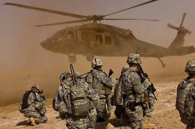 TAJI, Iraq - After completing a downed aircraft training exercise, Soldiers from Company F, 3rd Battalion, 1st Air Cavalry Brigade, 1st Cavalry Division, Multi-National Division - Baghdad, wait for a UH-60 Black Hawk helicopter to land before loading up and returning to the airfield, at Camp Taji, Iraq, north of Baghdad, June 10.