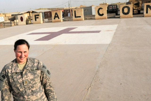BAGHDAD - East Carolina University graduate, 2nd Lt. Michelle Layton, serves as the brigade medical planner for the 30th Heavy Brigade Combat Team at Forward Operating Base Falcon, Iraq, on the southern edge of Baghdad.  The 2008 alum hopes to become a medical evacuation helicopter pilot after her tour in Iraq.