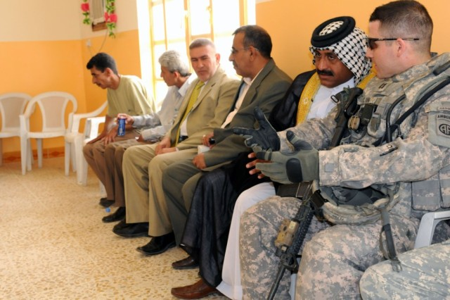 BAGHDAD - Capt. Patrick Flynn, of Raeford, N.C., speaks with key leaders of the city of Shawa Wa Um Jidir, located in the 9 Nissan District of eastern Baghdad during the opening of the civil support district center building. The center will offer hundreds of Iraqi civilians courses in road repair, generator repair, plumbing, electrical installation, sanitation and landscaping in order for them to find work in their local neighborhoods in their chosen career paths. Flynn serves as the commander for Company B, 2nd Battalion, 505th Parachute Infantry Regiment, 3rd Brigade Combat Team, 82nd Airborne Division, Multi-National Division - Baghdad.
